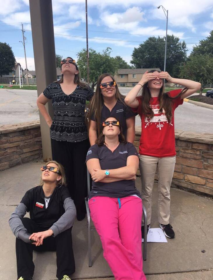 98.6% full eclipse in Omaha on August 21, 2017! I made Hannah a pinhole projector (by her feet in the picture), because she wanted to be as safe as possible! Back row, me, Jen, Hannah. Front row, Amy and Kelly.