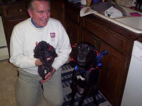 Dad with Ernie and Ebony. They were dressed as fancy French Poodles!