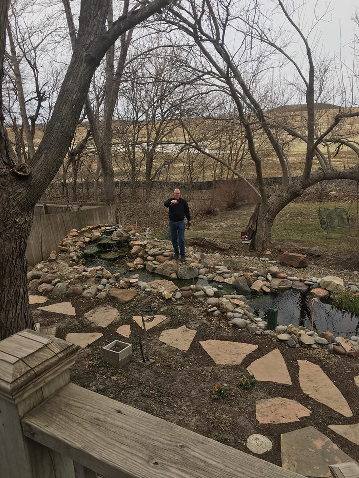 Dad fixing the pond