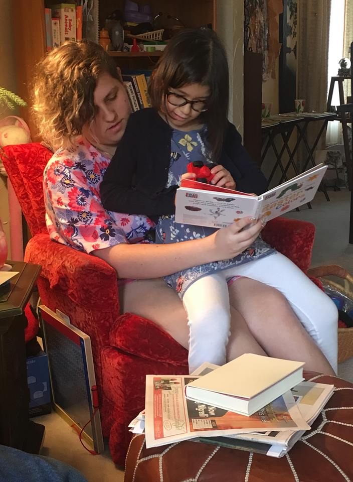 Amanda reading a book to Olive <3