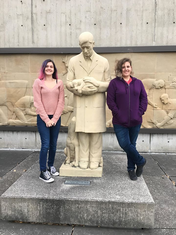 Abby and Amanda with the Gentle Doctor statue.