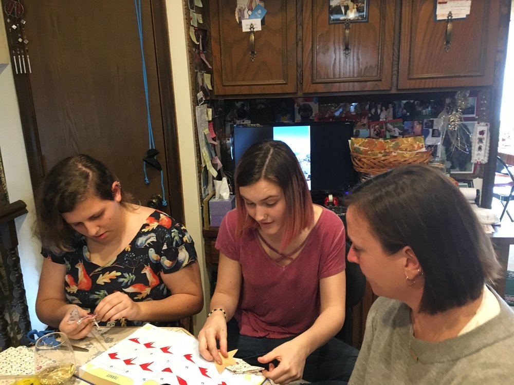 Amanda, Abby and Aunt Cara doing origami