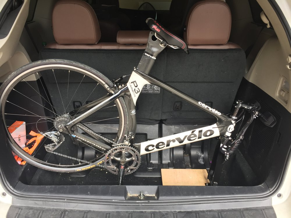 Headed to Florida - Full size Tri Bike in the back of a minivan without dropping the seats! Even threw the suit cases around it...