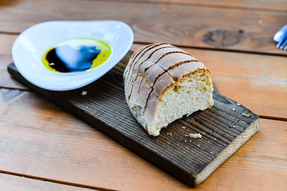 warm bread with olive oil and vinegar