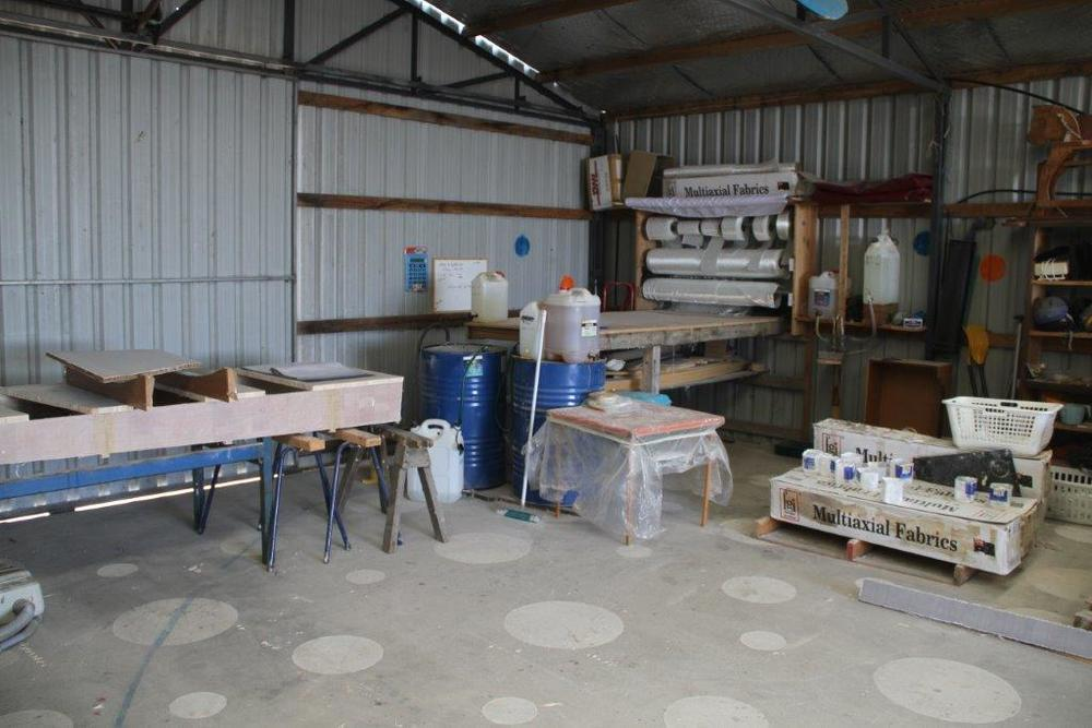 Our fiberglass section of the workshop.  This is the 10m x 13m shed of John's that we built the 10m x 18m boat shed immediately adjacent to.  Pictured in June 2010.