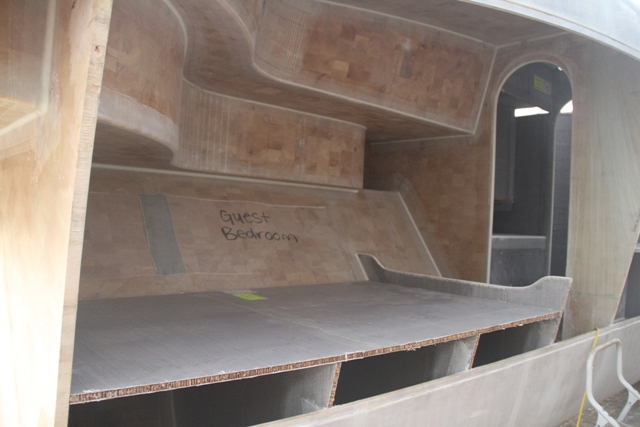 Furniture going in.  This is the aft cabin looking from outside the boat before the hull sheer panel was installed.  Interior spaces becoming defined allows for you to get a feel of the finished product.  April 2011.