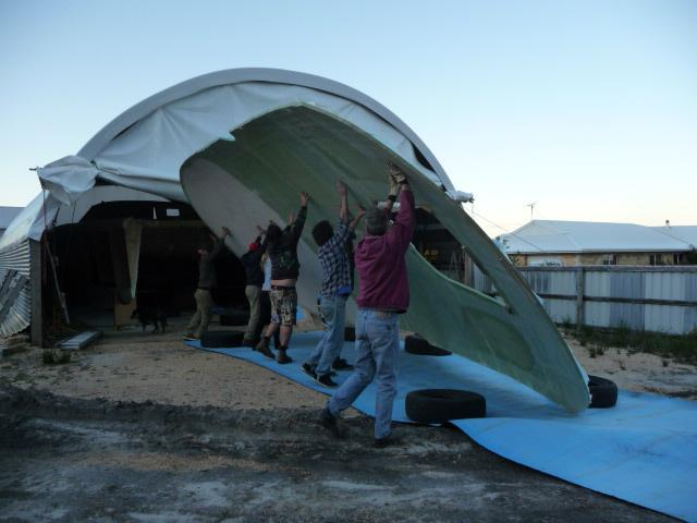 Rolling the cabin roof after completing the underside off the boat.  This was the largest laminating job of the build.  Hand lay up of the 4m x 10m panel.  September 2011.