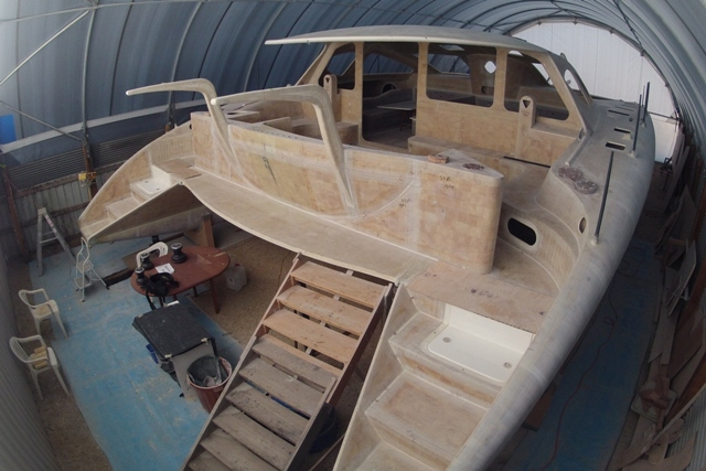 Back steps and engine hatches in, aft cockpit module and davits in place, work commenced on fitting out for the deck hardware.  March 2013.