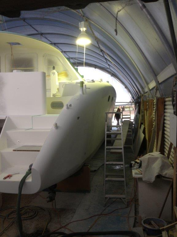 Working through the primer stages on the exterior. This slightly blurry photo helps to get a feel of the shed during this time.  Dealing with dust a constant issue of the fairing process.  September 2014.