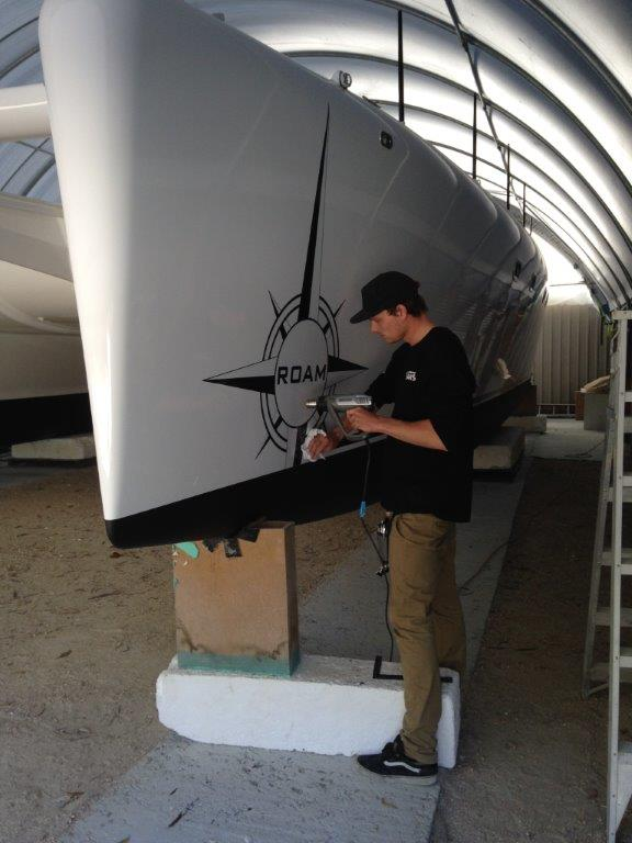 Decals installation.  Will Bakker did an awesome job of producing and applying Michael's design to the boat.  March 2015.