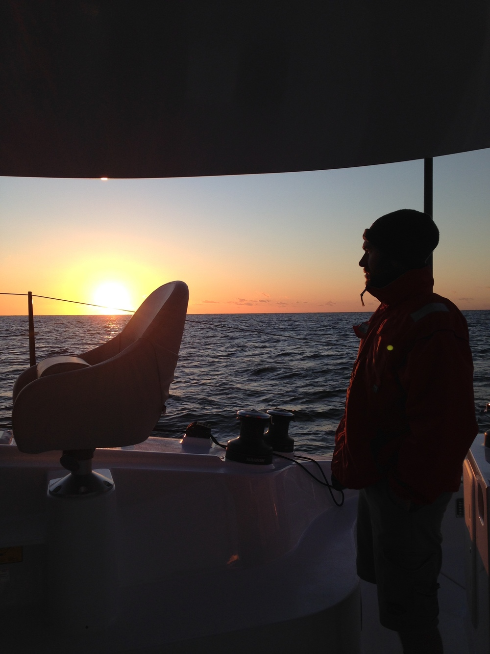 My Brother Joel Brill, watching the sun rise . Stoked to be aboard .