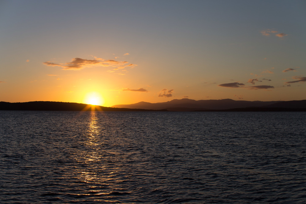 Sunset over Southport from Bruny Island.