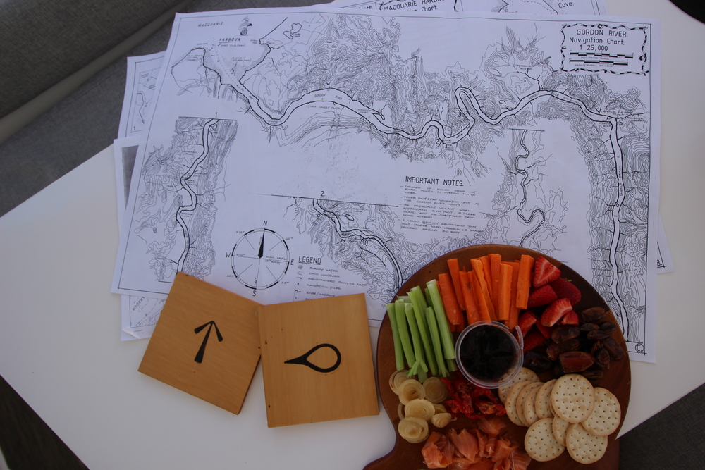 Trevor Nortons hand drawn maps laid out on the table with some nibbles. we plan our trip up the river.