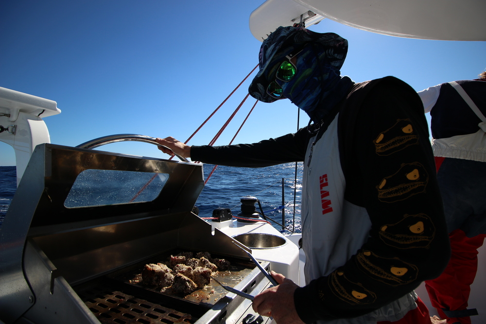 Captain Mick cooking up the Tuna we caught on the way on the BBQ.  Sporting his full sun protection. You need it living on a boat exposed to the sun majority of  the day.