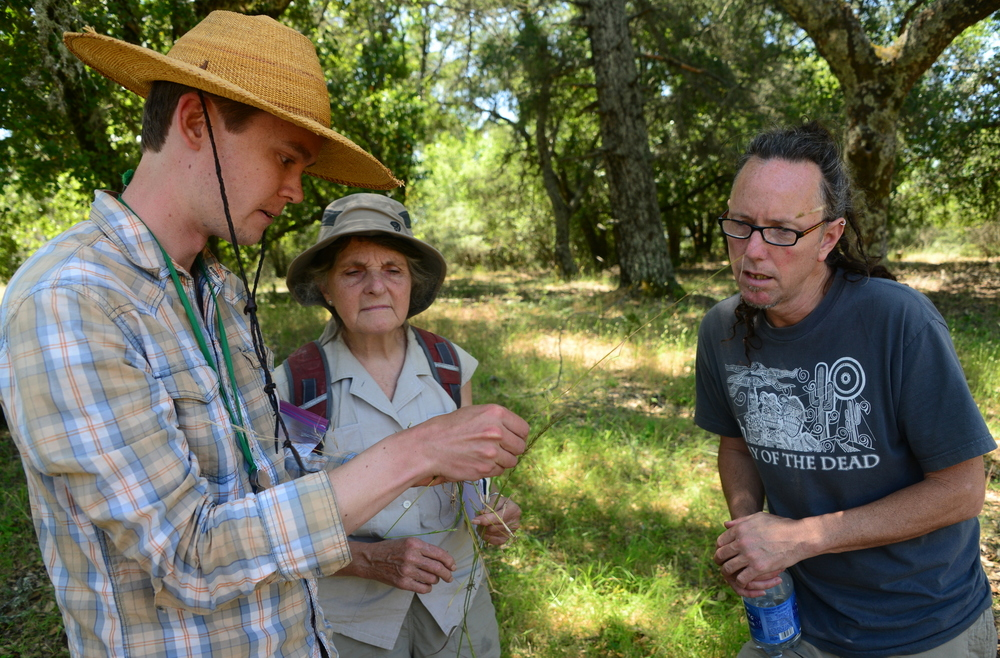 Joe Broberg helps identify a grass