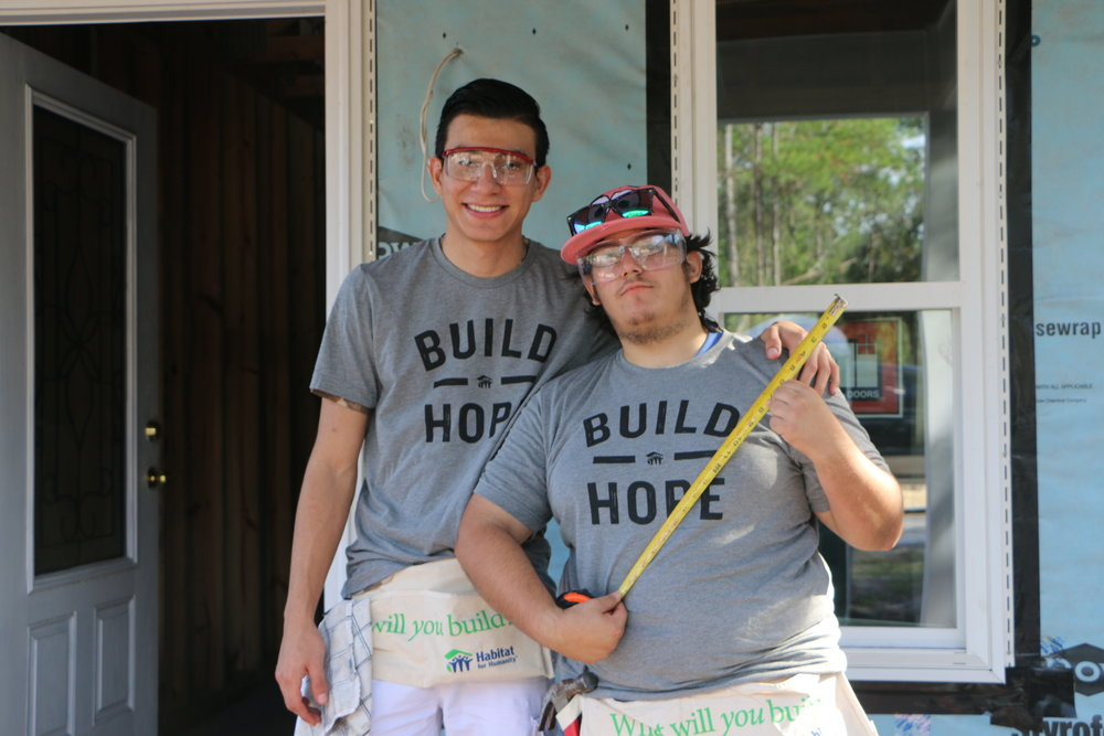 Two students from the Florida School for the Deaf and Blind Building a Tradesman program hard at work on a Habitat for Humanity build site.