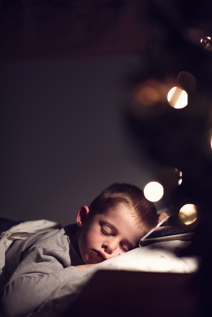 sleeping child beside Christmas Tree. Lovely Matters blog by Heather Walker