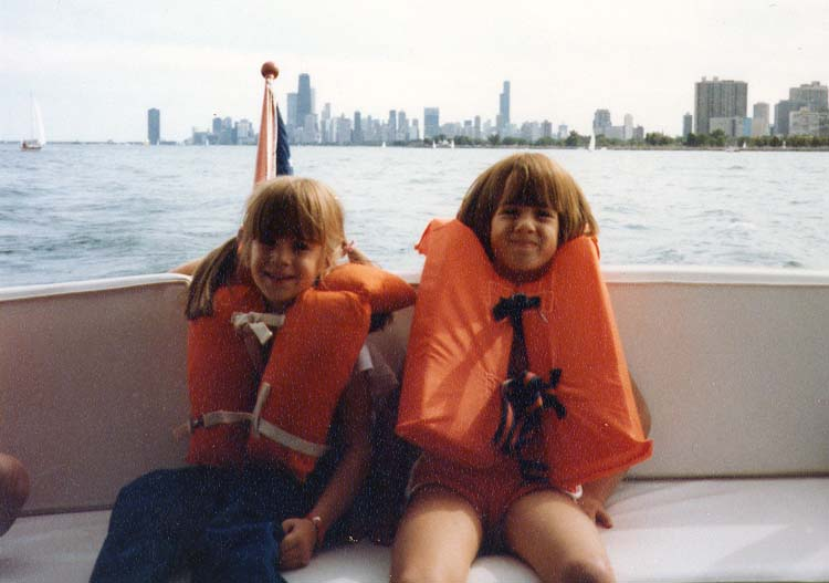 I'm on the left and my sister is the one looking like she's ready to barf into Lake Michigan.