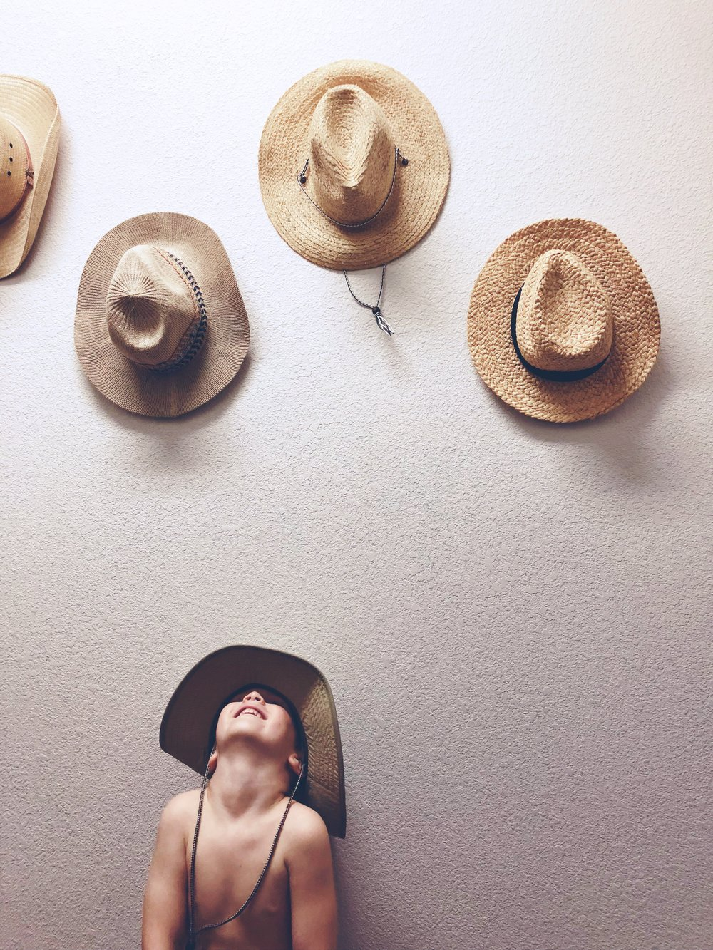 hats decorating a laundry room wall.  Lovely Matters blog - Lovely links in April - Heather Walker Photography