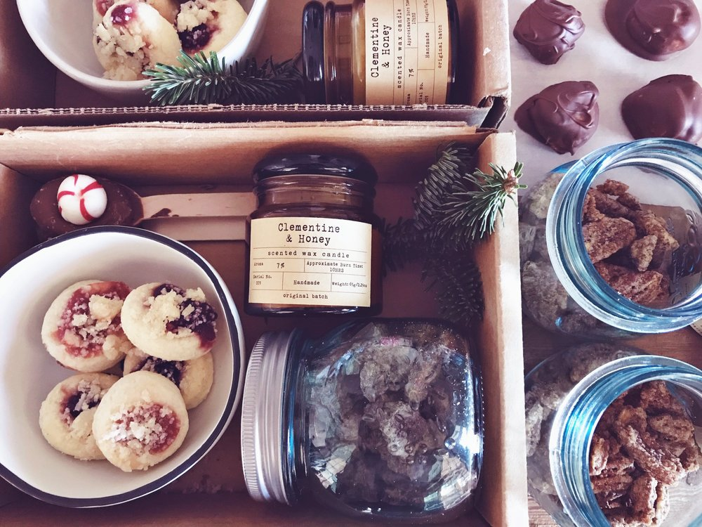 The gift boxes I made last year included my  Grandparent's Kolacky recipe ,  hot chocolate spoons , candied pecans,  magnolia bowls , peanut butter truffles (just peanut butter mixed with powdered sugar and dipped in chocolate), and my  favorite candle.
