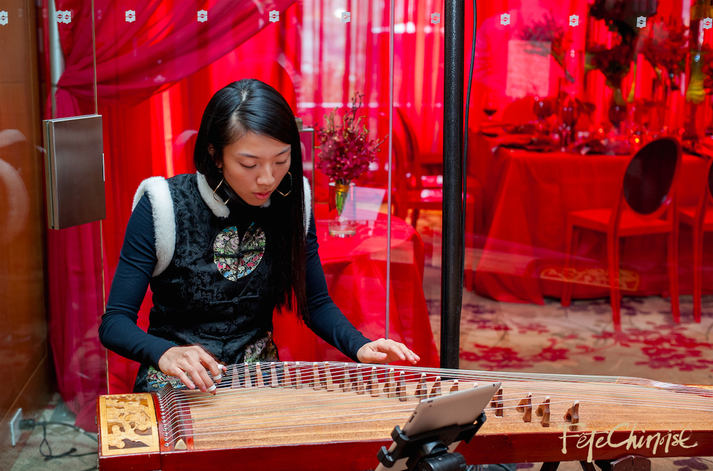 Dr. Claudia Hui plays the Gu Zheng in front of Red Room I. Photo by Krista Fox Photography.