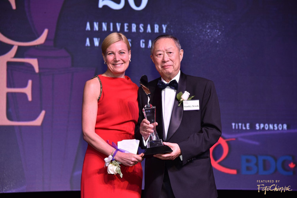 Kim Mason, Regional President of Greater Toronto Region at RBC presents Lifetime Achievement Award to Stanley Kwok