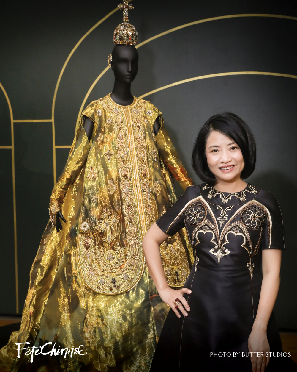 Guo Pei, haute couture designer, stands next to her work at the Vancouver Art Gallery. Photography by Butter Studios.
