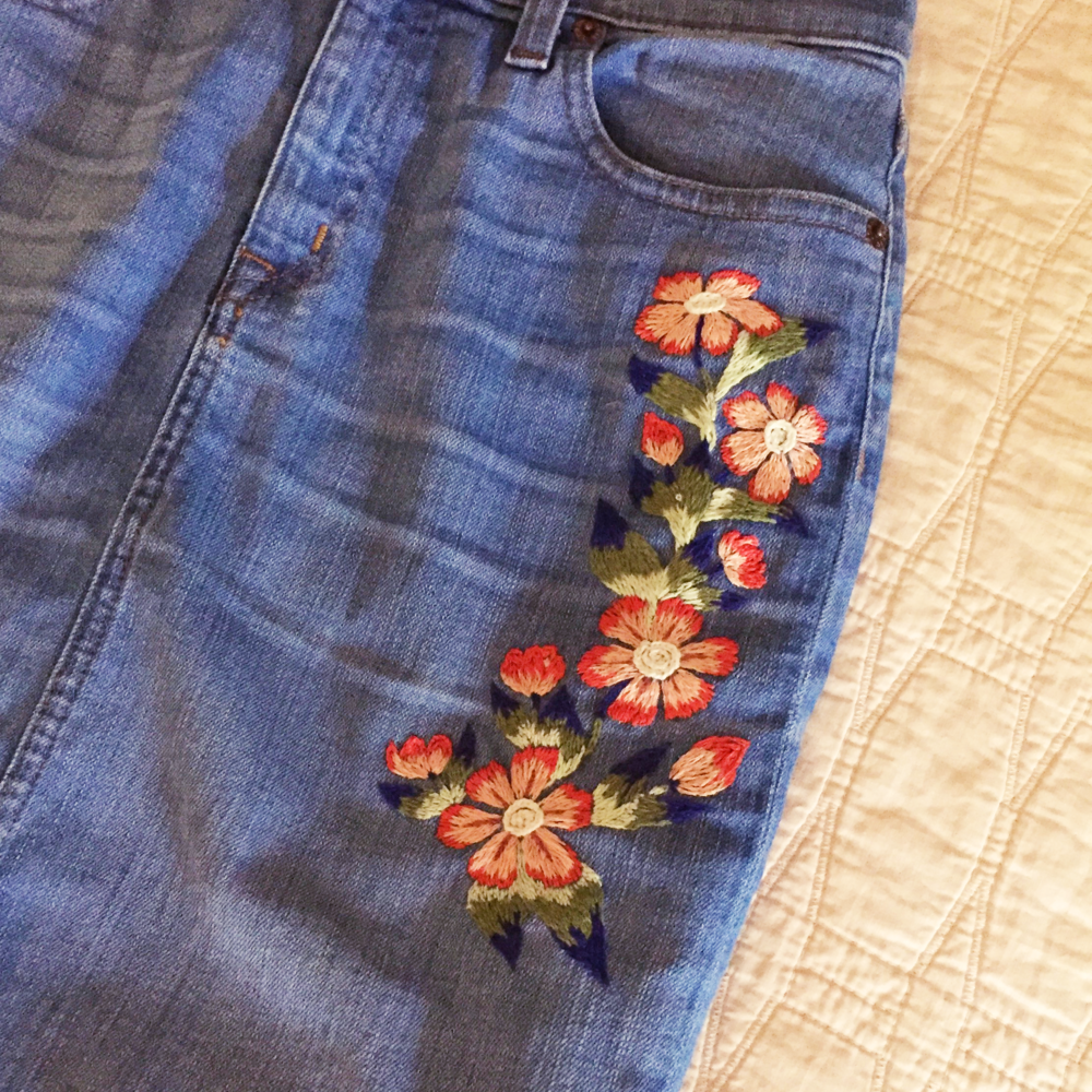 Embroidery on denim skirt.