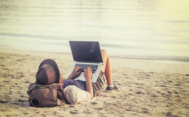 Shutterstock woman on computer at beach.jpg