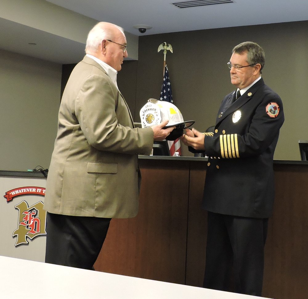 Left to Right:  Board Chairman Bill Esterline, Retiring Fire Chief Terry Loehrer.