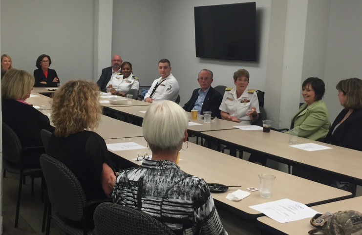 Rear Adm. McCormick-Boyle with local business leaders.