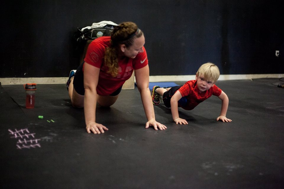 Serina and her youngest son doing push-ups for 2016 Memorial Day Murph