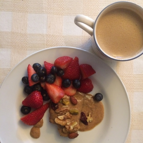 "My breakfast ""sugar fix"" on the Whole30: Fruit, Omega3 Trail Mix, Almond Butter, over  Coconut RX Bar  and bullet-proof coffee, blended with cinnamon, ghee and coconut oil."