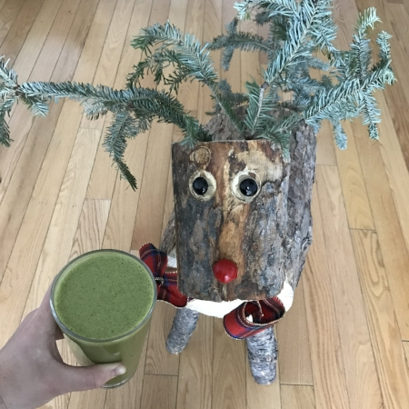What my green smoothie typically looks like in a cup  . . .  yes, with our pet reindeer from Christmas. #normal