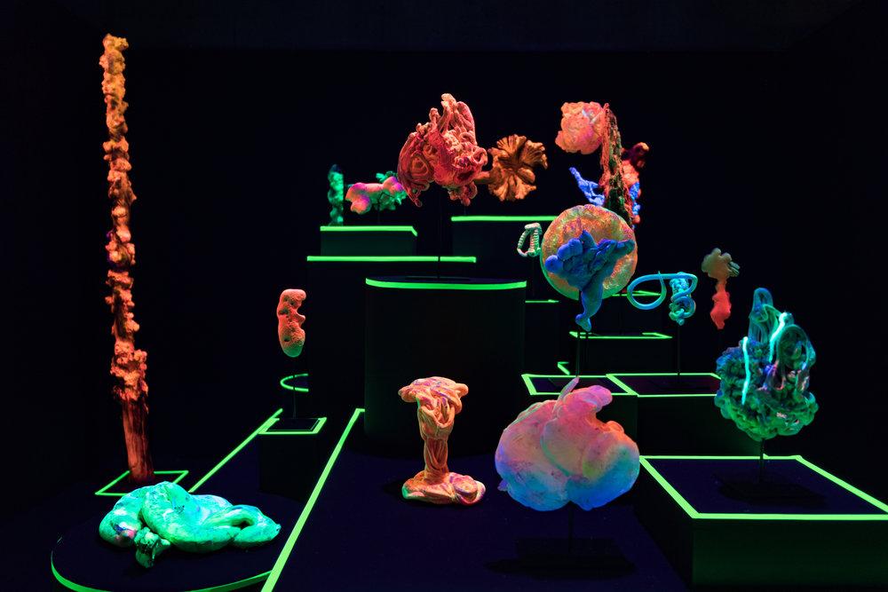 Cabinet de Curiosités , Concrétions, Pétrifications, 2018  Miguel Chevalier  Exposition «Digital Abysses », Base sous-marine, Bordeaux  Sculptures en résine, champignons naturels, bois et pigments fluo