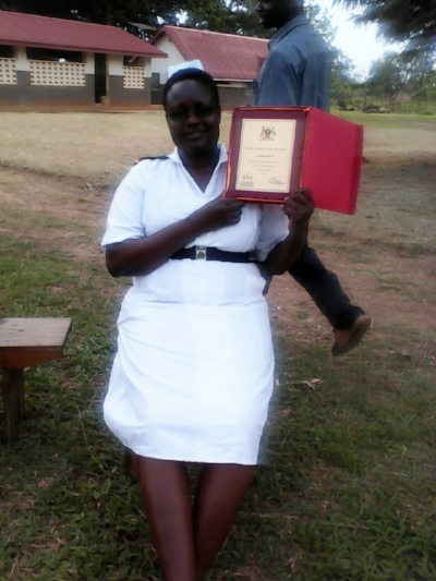 The Senior Nursing Officer showing her facility's award