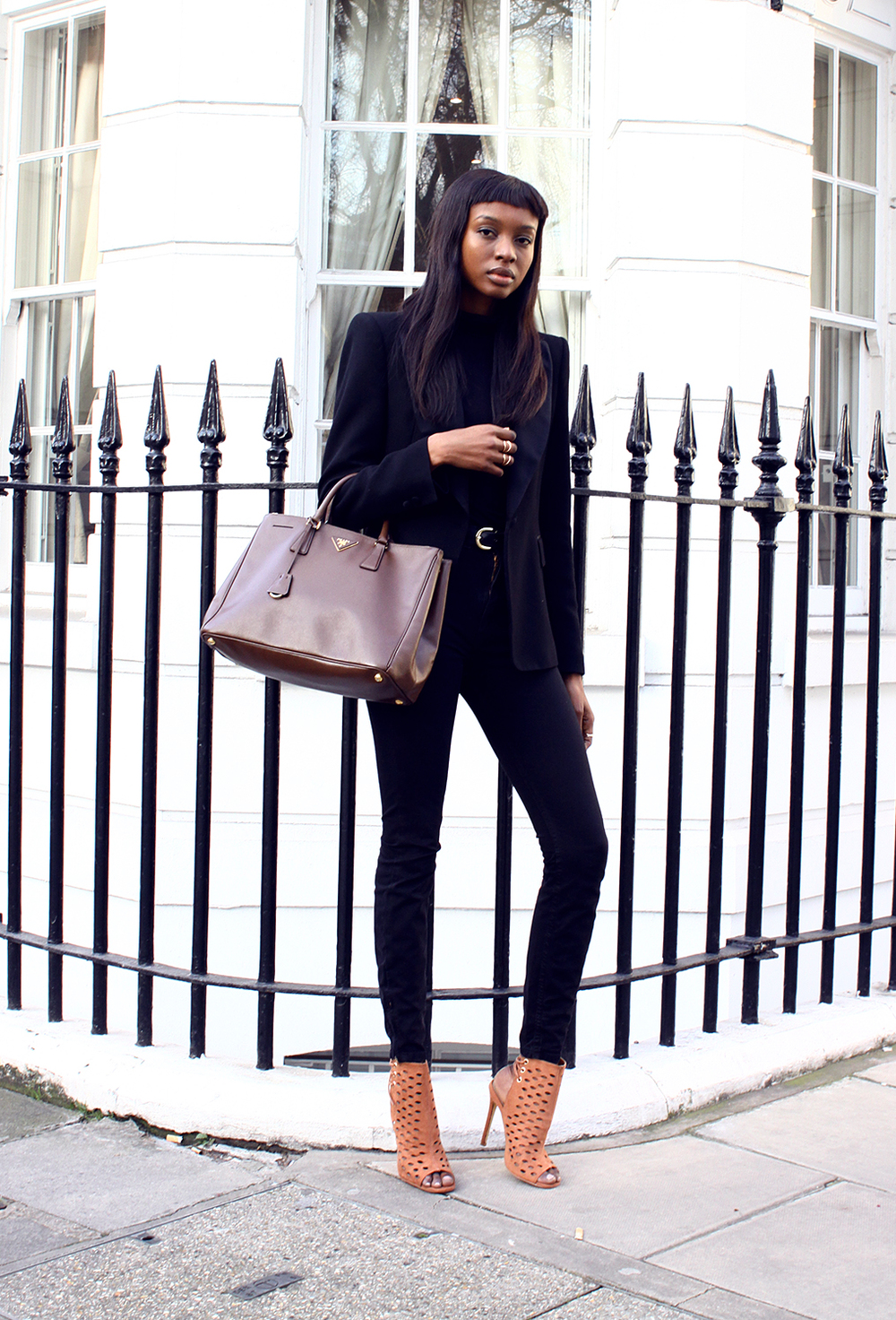 justthedesign: Street Style, March 2015: Natasha Ndlovu is wearing a black Zara blazer with an Asos turtleneck, American Apparel jeans and Missguided camel heels  Shoes on point