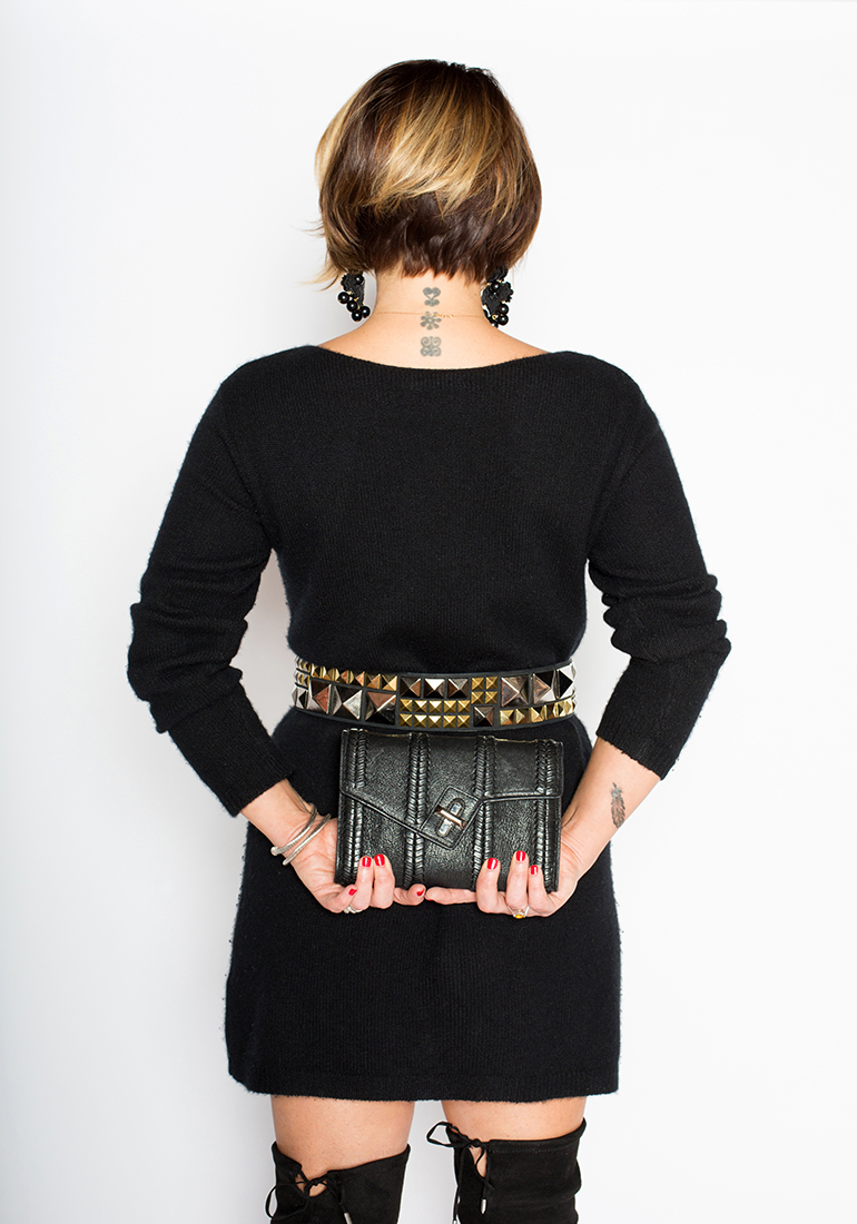 Key Holiday Accessories: Beaded earrings, studded waist belt, black textured clutch, over-the-knee boots