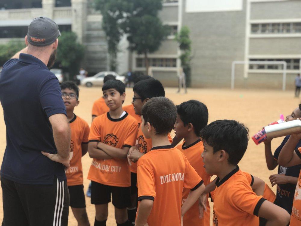 Coach Brett and team