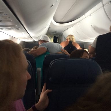 Tebow comforting the wife of a dying passenger.