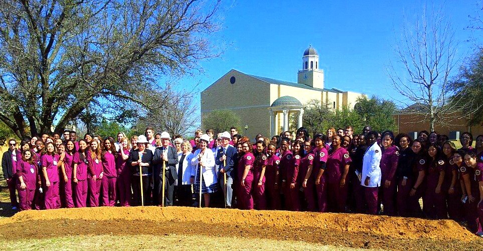 Holding shovels are: unknown, Larry Moore, Sallieann Hoffer, and Ken Shaw, flanked by the nursing students and nursing faculty of SWAU