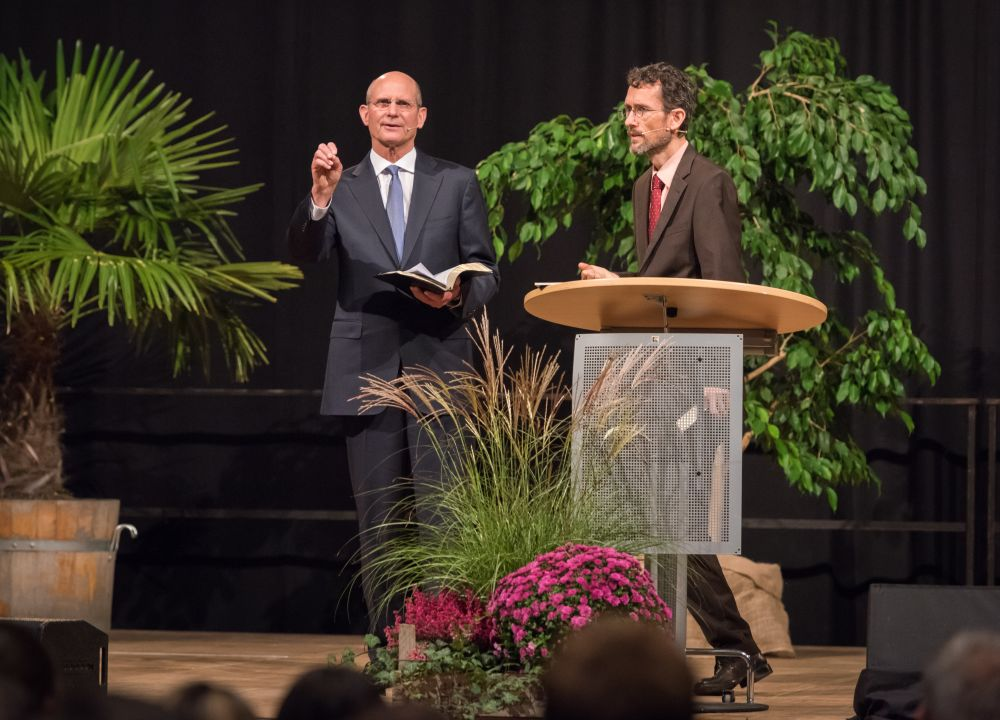 Johannes Kolletzki interpreting for Elder Ted Wilson in Hanover, Germany, on Oct. 21, 2017