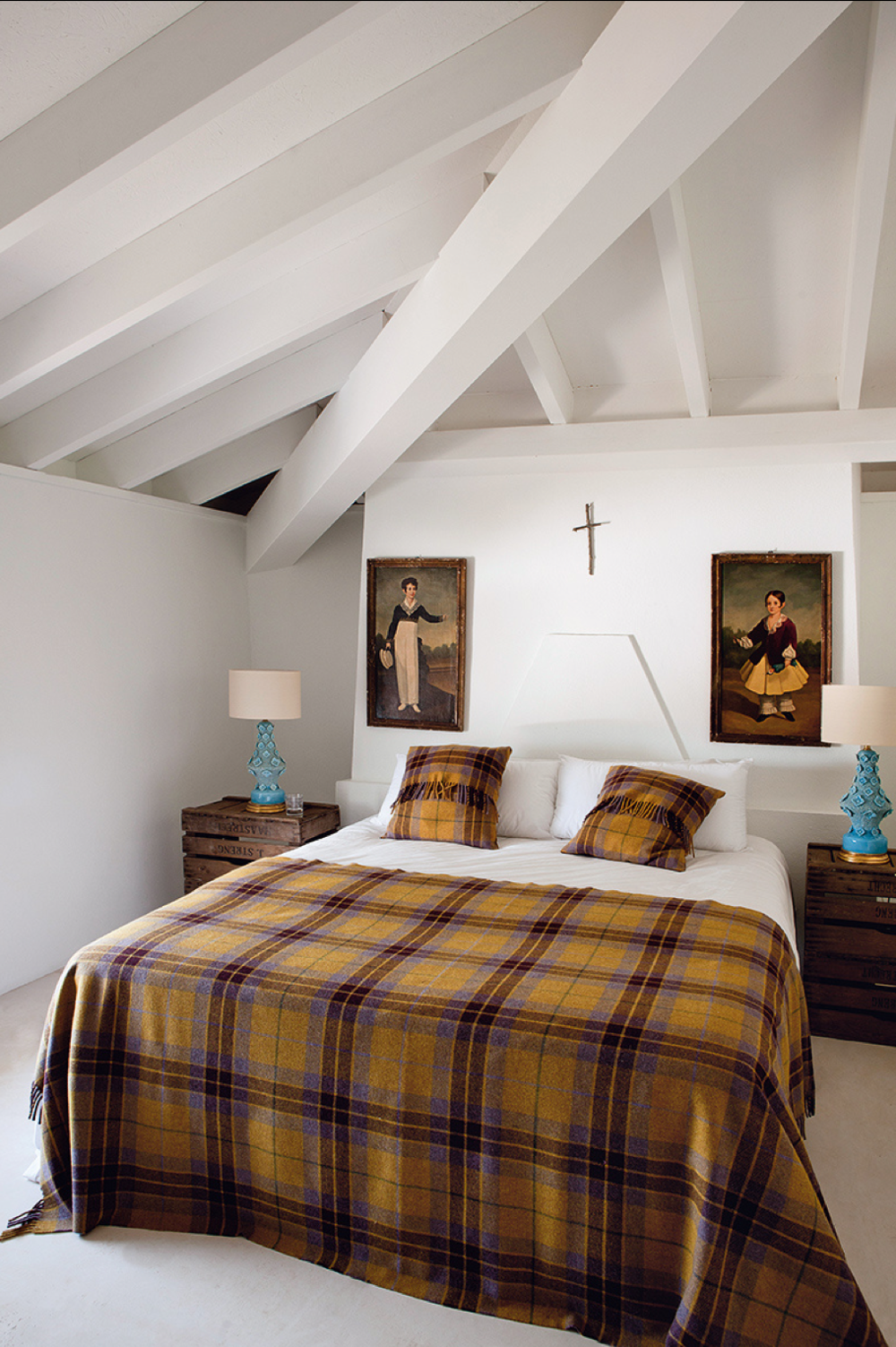 In love with the wall art, the plaid bedspread and the sweet cross.