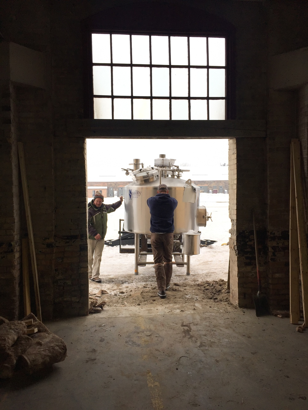 The Mash/Lauter tun making its way through what will someday be our patio door.