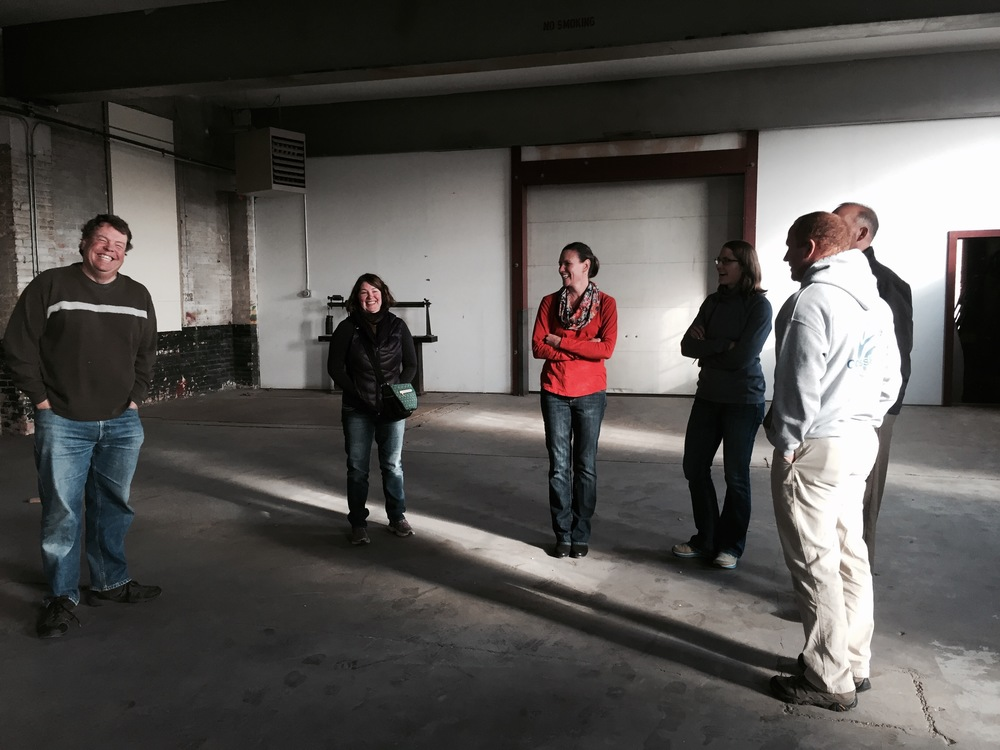 This is a photo of some of our better looking investors standing in the brewery on November 10th, 2015.
