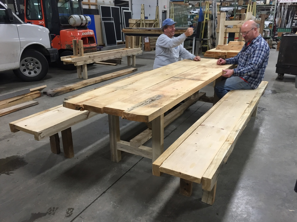 Dan and Chuck testing out a table and bench for routine use.