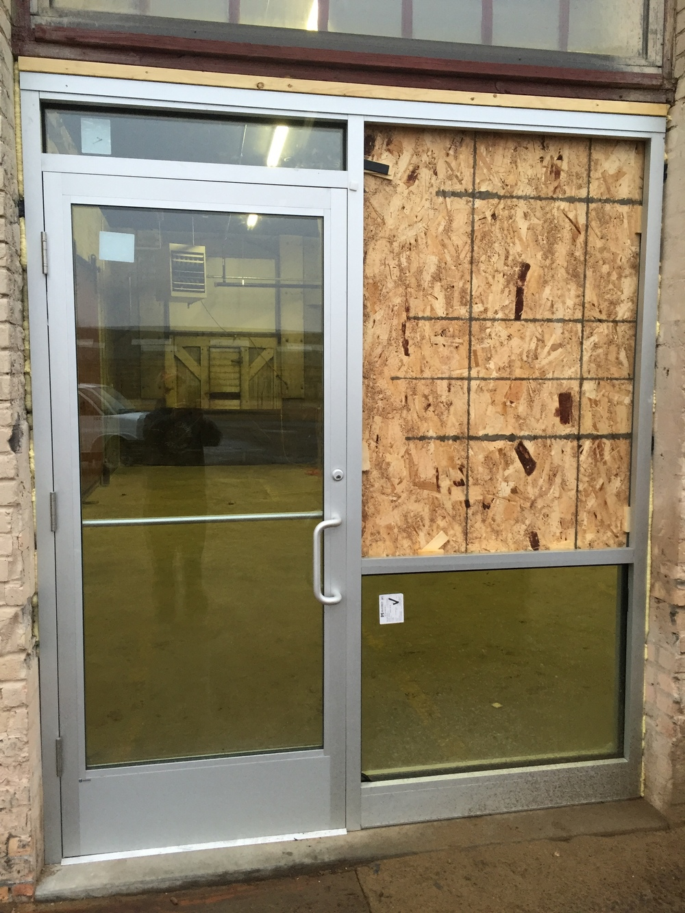 Our glass doors are kind of in.  We just couldn't let go of the particle board door we have been using all these months.