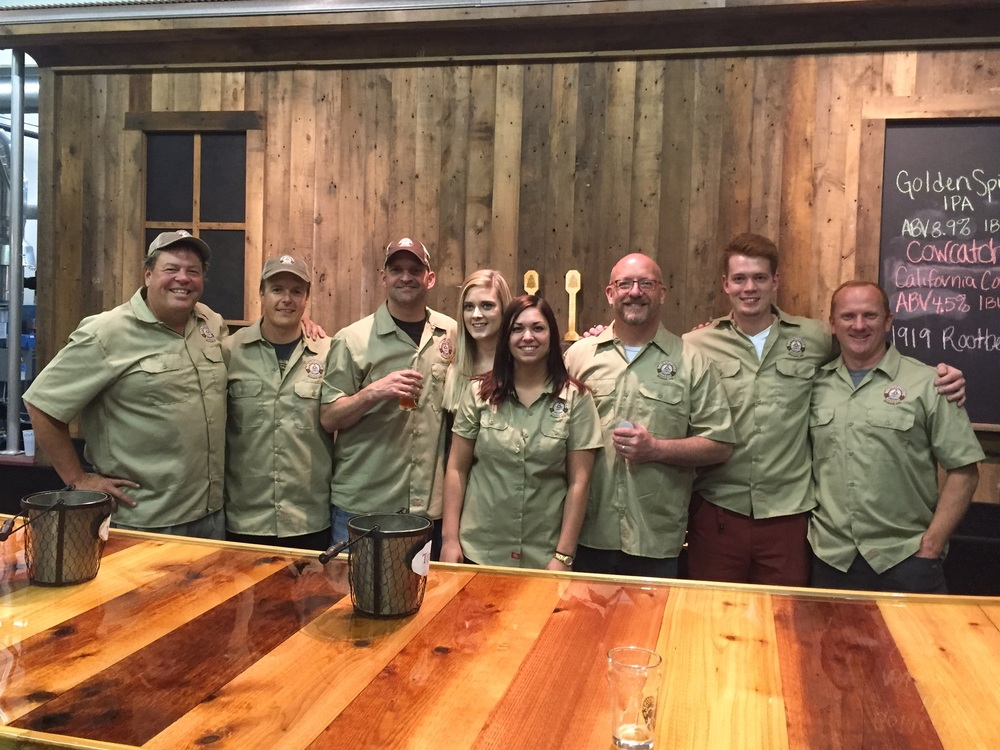 "Beer Scout Troop 1551 L to R:  Dan, Scott, Nick, Caroline, Nikki, Chuck, Logan, and Mark Motto - ""Be Prepared . . . to serve beer"""