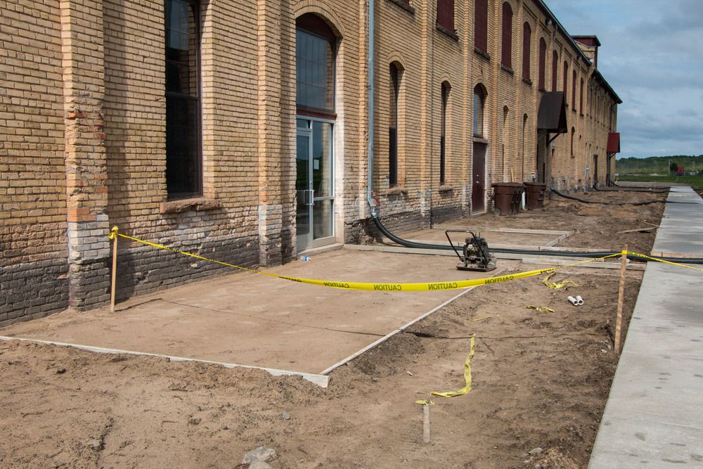 The Roundhouse sandbox will soon be filled in with cement to make our new patio.  We also have a sidewalk and soon to be paved parking lot.  And then, finally, what all you lycra wearing fitness freaks have been demanding, a bike rack.