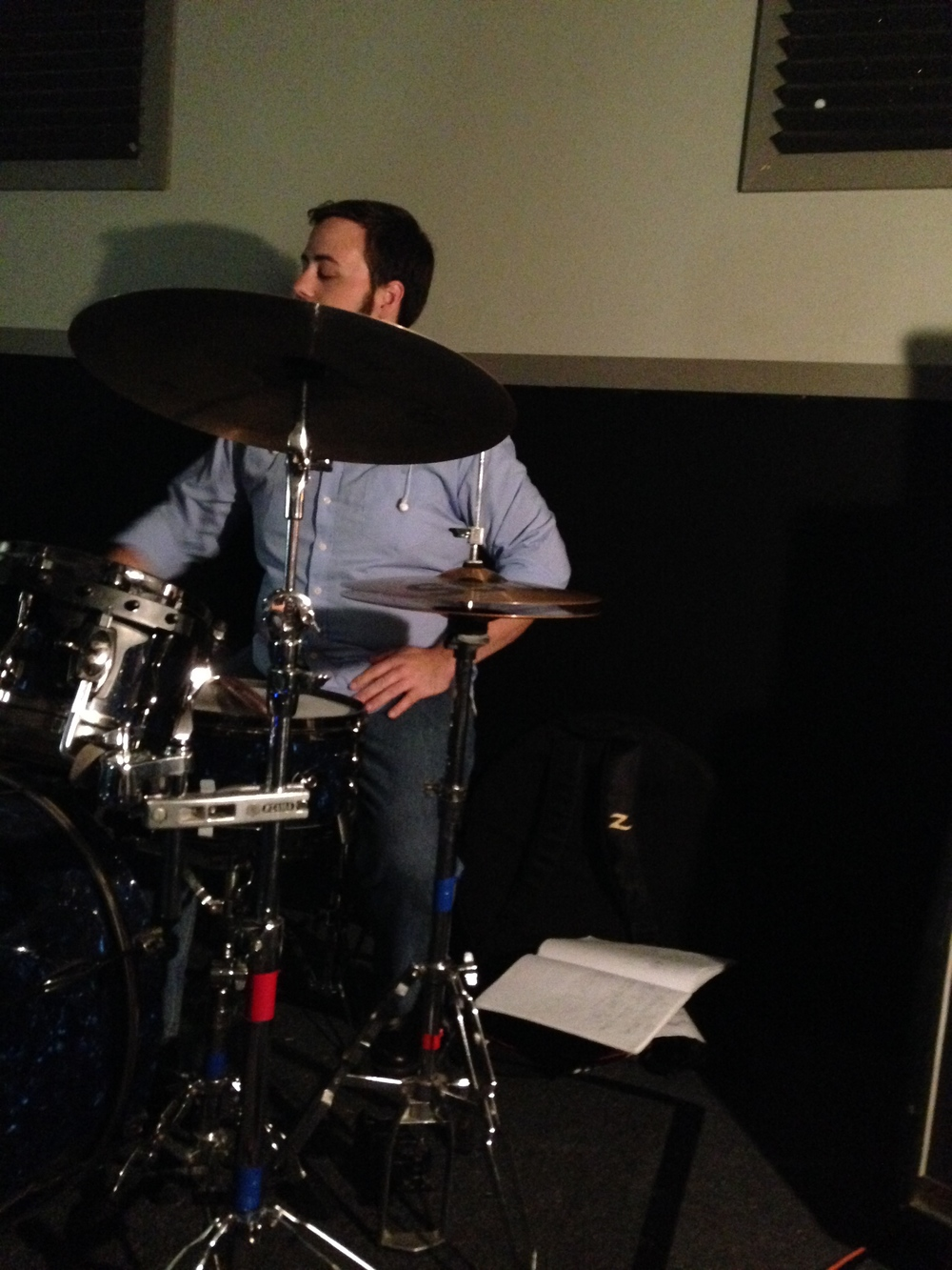 Playing Drums at a Rock Band Rehearsal.